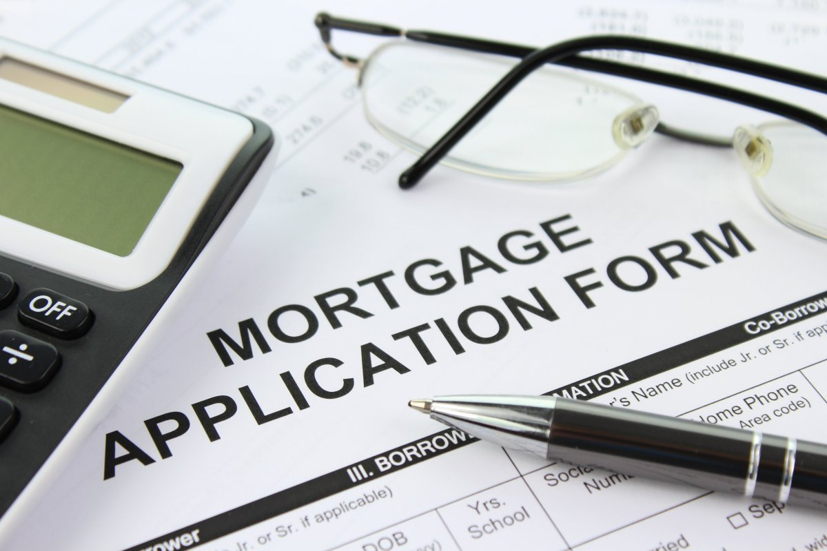 Filling out mortgage application after looking for houses for sale in Devon